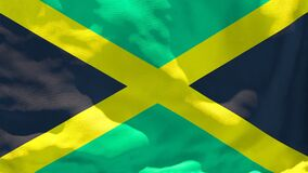 The national flag of Jamaica flutters in the wind