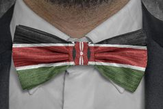 National flag of Kenya on bowtie business man suit royalty free stock photography