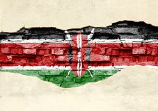National flag of Kenya on a brick background. Brick wall with partially destroyed plaster, background or texture stock photo