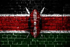 National flag of Kenya on a brick background. Concept image for Kenya: language , people and culture stock image