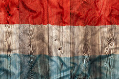 National flag of Luxembourg, wooden background Royalty Free Stock Photography