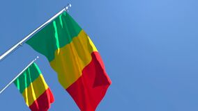 The national flag of Mali flutters in the wind against the sky