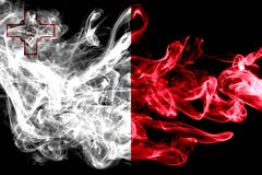 National flag of Malta made from colored smoke isolated on black background. Abstract silky wave background. National flag of Malta made from colored smoke Stock Photos