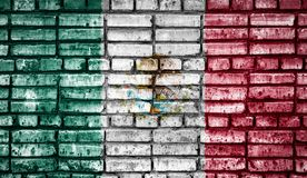 National flag on a brick background. National flag of Mexico on a brick background. Concept image for Mexico: language , people and culture royalty free stock photo