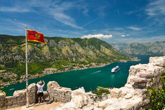 The national flag of Montenegro. And the view on Kotor bay from Lovcen Mountain. Montenegro Stock Image