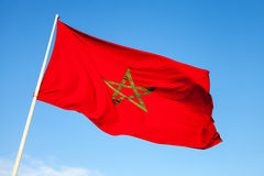 National flag of Morocco above blue sky Royalty Free Stock Photo