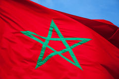 National flag of Morocco above blue sky Stock Photos