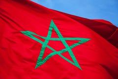National flag of Morocco above blue sky Stock Photos