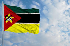 National flag of Mozambique in front of blue sky Royalty Free Stock Photos