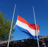 National flag of the Netherlands, half-staff. Official flag of the Netherlands, hanging half-staff as a symbol of respect royalty free stock photography