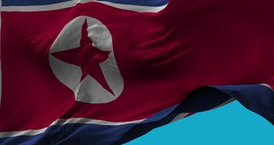 National Flag of  North Korea waving in the wind slow motion stock video footage