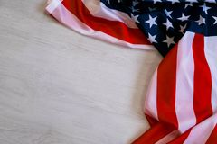Free National Flag Of USA. Natural Light. Selective Focus. Close Up On A Gray Background. Top View, Flat Lay. Copy Space. Royalty Free Stock Image - 103856446