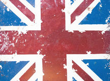 National flag on old rusty grunge background. Concept of national flag on old rusty grunge background: UK Royalty Free Stock Image