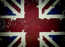 National flag on old rusty grunge background. Old rusty metal sign with a flag - United Kingdom , dark vignette Royalty Free Stock Image
