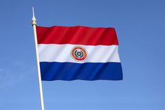 National flag of Paraguay. Adopted in 1842. It is unusual because the insignia differs on obverse and reverse sides of the flag (this the obverse side royalty free stock photos