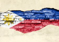 National flag of Philippines on a brick background. Brick wall with partially destroyed plaster, background or texture royalty free illustration
