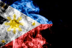 National flag of Philippines. From thick colored smoke on a black isolated background stock photos