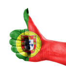 National flag of Portugal over hand Stock Images