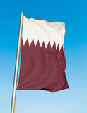 National flag of Qatar on flagpole Royalty Free Stock Photos