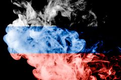 National flag of Russia. From thick colored smoke on a black isolated background Stock Images