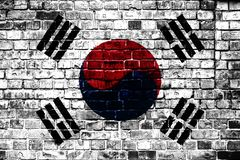 National flag of South Korea on a brick background. Concept image for South Korea: language , people and culture royalty free stock photos