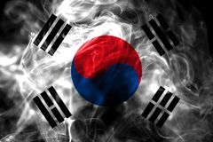 National flag of South Korea made from colored smoke isolated on black background. Abstract silky wave background. National flag of South Korea made from royalty free stock photos