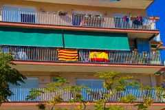 The national flag of Spain and the flag of Catalonia are hung out together. Royalty Free Stock Image