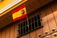 The national flag of Spain is exposed in a window . The national flag of Spain is exposed in a window with bars Royalty Free Stock Photography
