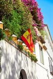 The national flag of Spain hang on the balcony Stock Images