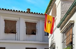 The national flag of Spain hang on the balcony Royalty Free Stock Photography