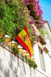 The national flag of Spain hang on the balcony Stock Photography