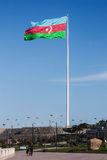 National Flag Square is a large city square off Neftchiler Avenue in Baku.  A flag measuring 70 by 35 metres flies on a pole 162 m. National Flag Square is a Stock Photography