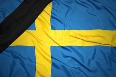 National flag of sweden with black mourning ribbon. Waving national flag of sweden with black mourning ribbon Royalty Free Stock Photos