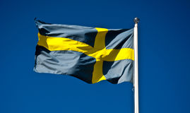 National Flag of Sweden. Waving against a blue sky Stock Images