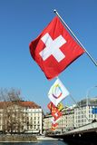 Swiss flag on Mont-Blanc bridge in Geneva, Switzerland. Stock Photo