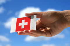 National flag of Switzerland over visiting card Royalty Free Stock Photos