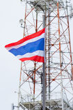 National flag of Thailand and telecommunication tower Stock Photos