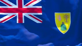 The national flag of Turks and Caicos Islands flutters in the wind
