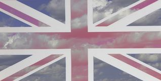 National flag of UK background of blue sky and clouds royalty free stock images