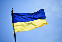 National flag of Ukraine. With background of clear blue sky Stock Photography