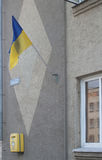 National flag of Ukraine on a building wall Stock Photos