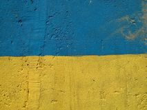 National flag of Ukraine. National flag, or ensign, of People's Republic of Ukraine with blue and yellow parts painted onto rough textured surface Stock Photos