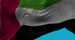 National Flag of  United Arab Emirates waving in the wind slow motion. Seamless Loop Animation stock footage