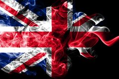 National flag of United Kingdom made from colored smoke isolated on black background. Abstract silky wave background stock illustration