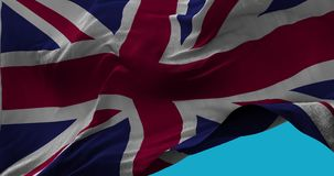 National Flag of United Kingdom waving in the wind slow motion Seamless Loop. Animation stock footage