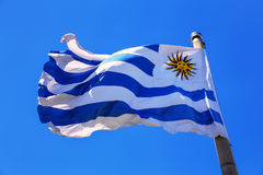 National flag of Uruguay flying in blue sky Royalty Free Stock Image