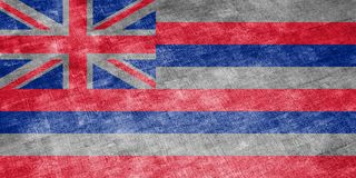 The national flag of the US state Hawaii in against a gray textile rag on the day of independence in different colors of blue red stock illustration