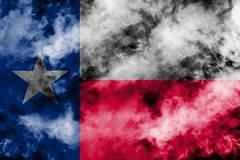 The national flag of the US state Texas in against a gray smoke on the day of independence in different colors of blue red and vector illustration