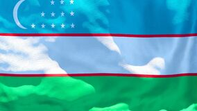 The national flag of Uzbekistan flutters in the wind