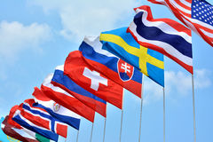 National flags. Different countries national flags getting together under blue sky, shown as worldwide, country, and international communication or activities Stock Images